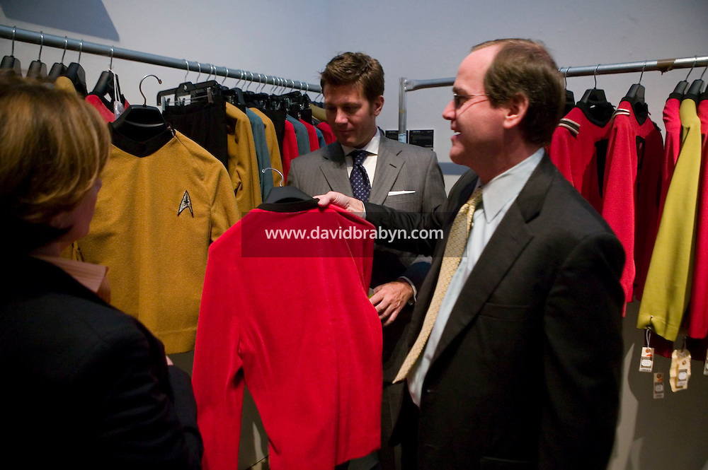 2 October 2006 - New York City, NY - JP Morgan employees on a break examine costumes on display at the preview of items from the TV show Star Trek at Christie's auction house in New York City, USA, 2 October 2006. The auction, on October 5-7, is a celebration of the show's 40th anniversary.