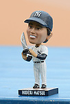 Hideki Matsui bobblehead doll,<br /> JULY 28, 2013 - MLB :<br /> Hideki Matsui's official retirement ceremony before the Major League Baseball game between the Tampa Bay Rays and the New York Yankees at Yankee Stadium in The Bronx, New York, United States. (Photo by AFLO)