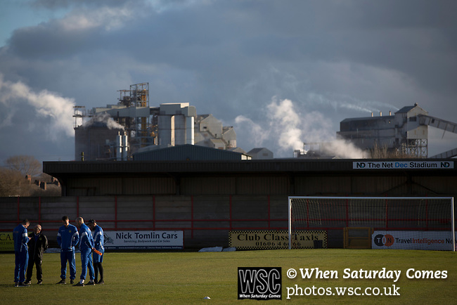 Witton Albion 1 Warrington Town 2, 26/12/2017. Wincham Park, Northern Premier League. Visiting players on the pitch at Wincham Park, home of Witton Albion before their Northern Premier League premier division fixture with Warrington Town. Formed in 1887, the home team have played at their current ground since 1989 having relocated from the Central Ground in Northwich. With both team chasing play-off spots, the visitors emerged with a 2-1 victory, the winner being scored by Tony Gray in second half injury time, watched by a crowd of 503. Photo by Colin McPherson.