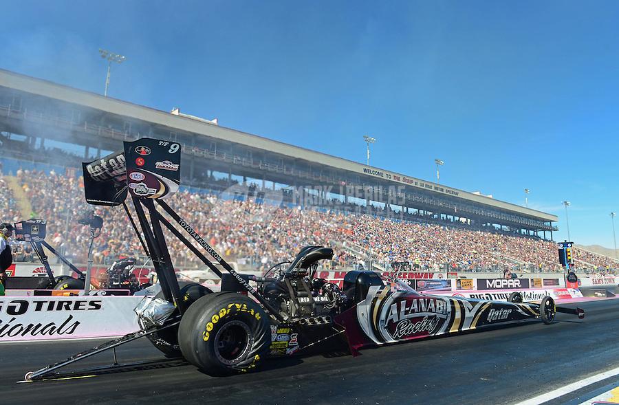 Oct. 27, 2012; Las Vegas, NV, USA: NHRA top fuel driver Shawn Langdon during qualifying for the Big O Tires Nationals at The Strip in Las Vegas. Mandatory Credit: Mark J. Rebilas-