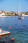 Locals and tourists enjoying the sea on the island of Hvar, Croatia.