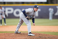 UNCG Spartans relief pitcher Blair Betts (25) looks to his catcher for the sign against the High Point Panthers at Willard Stadium on February 14, 2015 in High Point, North Carolina.  The Panthers defeated the Spartans 12-2.  (Brian Westerholt/Four Seam Images)