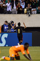 Mexico midfielder Angel Reyna (8) celebrates scoring. Mexico defeated the Ivory Coast 4-1 during an international friendly at MetLife Stadium in East Rutherford, NJ, on August 14, 2013.
