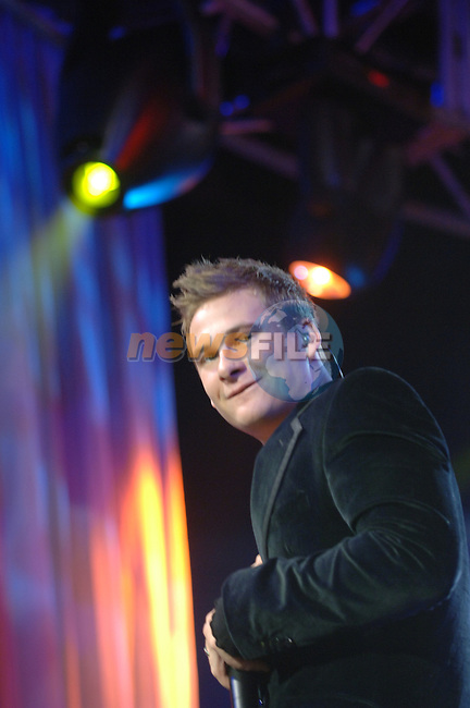 Lee Ryan on stage at the 2006 Childline Concert in the Point Depot in Dublin...Photo NEWSFILE/Colin Bell.(Photo credit should read Colin Bell/NEWSFILE)....This Picture has been sent you under the condtions enclosed by:.Newsfile Ltd..The Studio,.Millmount Abbey,.Drogheda,.Co Meath..Ireland..Tel: +353(0)41-9871240.Fax: +353(0)41-9871260.GSM: +353(0)86-2500958.email: pictures@newsfile.ie.www.newsfile.ie.FTP: 193.120.102.198..