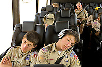 Photo story of Philmont Scout Ranch in Cimarron, New Mexico, taken during a Boy Scout Troop backpack trip in the summer of 2013. Photo is part of a comprehensive picture package which shows in-depth photography of a BSA Ventures crew on a trek. In this photo,  exhausted Boy Scouts take a brief nap on the long bus trip from Denver, Co, to the Philmont Scout Ranch,  in Cimarron, New Mexico.<br /> <br /> Photo by travel photograph: PatrickschneiderPhoto.com