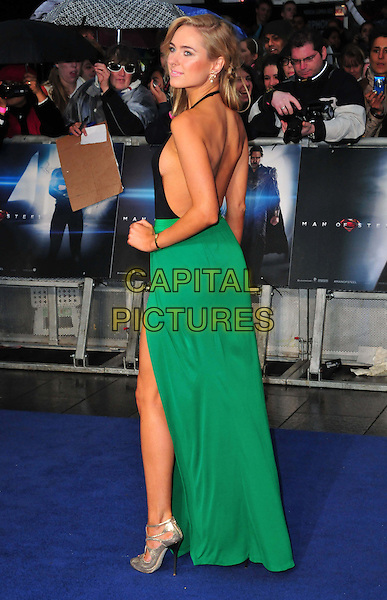 Kimberley Garner<br /> 'Man Of Steel' UK film premiere, Empire cinema, Leicester Square, London, England.<br /> 12th June 2013<br /> full length black halterneck top green skirt hand on hip side looking over shoulder silver shoes side boob slit split<br /> CAP/BF<br /> &copy;Bob Fidgeon/Capital Pictures