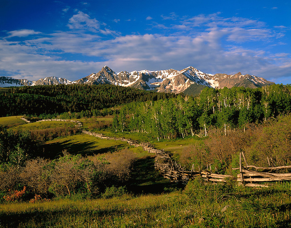 Sneffels range with wood fence at Dallas Divide, Telluride, Colorado, USA John guides custom photo tours in the Sneffels Range and throughout Colorado.