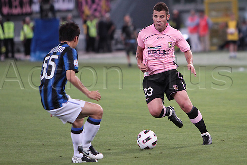 29.05.2011. Final Coppa Italia (Tim Cup) Stadio Olimpico, Rome, Italy. Nocerino of Palermo  battles with Nagatomo of Inter Milan during the Final Tim Cup match Inter Milan versus Palermo at the Olipic Stadium on Italy.