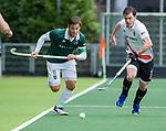 AMSTELVEEN - Jeroen Hertzberger (R'dam)  met Fergus Kavanagh (Adam)    tijdens de hoofdklasse competitiewedstrijd heren, AMSTERDAM-ROTTERDAM (2-2). COPYRIGHT KOEN SUYK