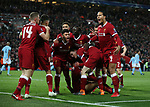 Mohamed Salah of Liverpool is mobbed by his team mates after scoring the first goal during the Champions League Quarter Final 1st Leg, match at Anfield Stadium, Liverpool. Picture date: 4th April 2018. Picture credit should read: Simon Bellis/Sportimage