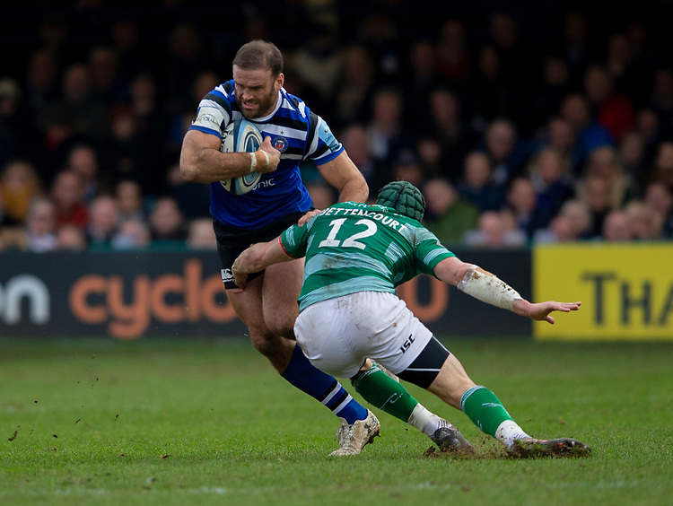 Bath's Jamie Roberts evades the tackle of Newcastle's Pedro Bettencourt<br /> <br /> Photographer Bob Bradford/CameraSport<br /> <br /> Gallagher Premiership - Bath Rugby v Newcastle Falcons - Saturday 16th February 2019 - The Recreation Ground - Bath<br /> <br /> World Copyright © 2019 CameraSport. All rights reserved. 43 Linden Ave. Countesthorpe. Leicester. England. LE8 5PG - Tel: +44 (0) 116 277 4147 - admin@camerasport.com - www.camerasport.com