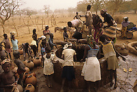 Women and children fetching water at a traditional well