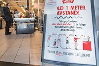 Sign urging shopers to keep distance. Norwegian authorites introduced measures to combat the Coronavirus (COVID-19).<br />