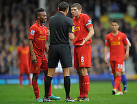 28.10.2012 Liverpool, England. Steven Gerrard and Raheem Sterling of Liverpool discuss a point with the  referee  during the Premier League game between Everton and Liverpool  from Goodison Park ,Liverpool