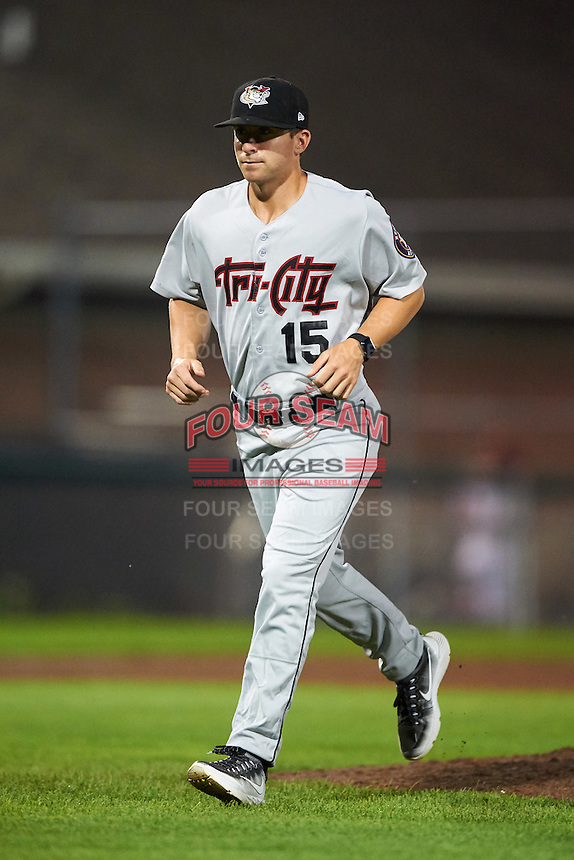 Tri-City ValleyCats pitching coach Drew French (15) jogs to the dugout after a mound visit during a game against the Auburn Doubledays on August 25, 2016 at Falcon Park in Auburn, New York.  Tri-City defeated Auburn 4-3.  (Mike Janes/Four Seam Images)