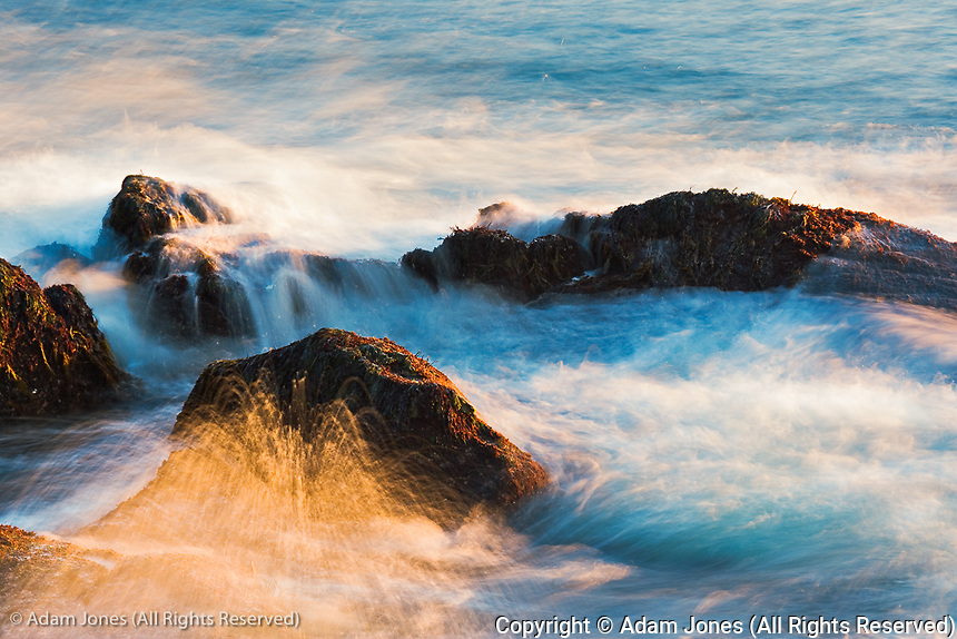 Waves in the Atlantic Ocean crashing against granite coastline at sunrise, Acadia National Park, Maine