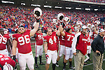 Wisconsin Badgers raise their helmets prior to the opening kickoff during an NCAA Big Ten Conference college football game against the Penn State Nittany Lions on November 26, 2011 in Madison, Wisconsin. The Badgers won 45-7. (Photo by David Stluka)