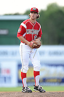 Batavia Muckdogs pitcher Michael Mader (21) gets ready to deliver a pitch during a game against the Williamsport Crosscutters on July 27, 2014 at Dwyer Stadium in Batavia, New York.  Batavia defeated Williamsport 6-5.  (Mike Janes/Four Seam Images)