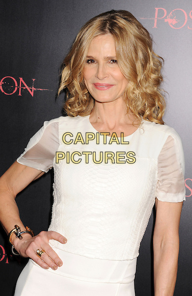"Kyra Sedgwick.""The Possession"" Los Angeles Premiere held at Arclight Cinemas, Hollywood, California, USA..August 28th, 2012.half length dress white sheer hand on hip.CAP/ROT/TM.©Tony Michaels/Roth Stock/Capital Pictures"