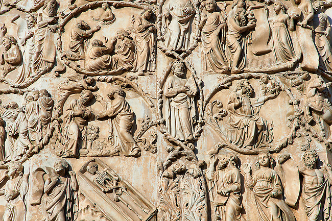 Bas-relief sculpture panel with scenes from the Bible by Maitani around 1310 on the14th century Tuscan Gothic style facade of the Cathedral of Orvieto, Umbria, Italy