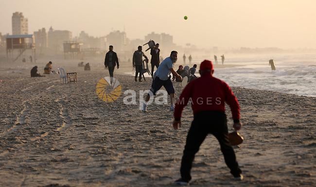 Palestinians play tennis along the along the Mediterranean coast at the beach of Gaza city, February 11, 2019. Photo by Mahmoud Naser