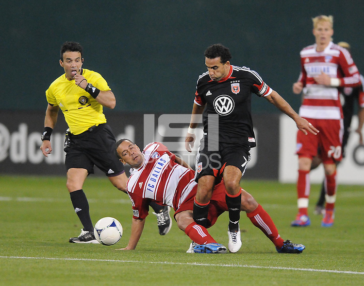 D.C. United forward Dwayne De Rosario (7) gets tackle by FC Dallas midfielder Daniel Hernadez (2) D.C. United defeated FC Dallas 4-1 at RFK Stadium, Friday March 30, 2012.