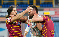 Picture by Allan McKenzie/SWpix.com - 11/05/2018 - Rugby League - Ladbrokes Challenge Cup - Huddersfield Giants v Wakefield Trinity - John Smith's Stadium, Huddersfield, England - Wakefield's David Fifita fends off Huddersfield's Jake Mamo and Danny Brough.