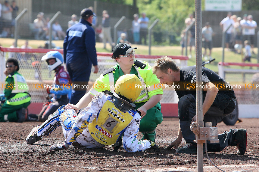 Heat 12: Concern for Timo Lahti of Eastbourne after he crashes out on the last lap - Lakeside Hammers vs Eastbourne Eagles - Elite League Speedway at Arena Essex Raceway - 22/04/11 - MANDATORY CREDIT: Gavin Ellis/TGSPHOTO - Self billing applies where appropriate - Tel: 0845 094 6026
