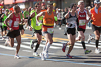NEW YORK - NOVEMBER 7: Indalecio Rodriguez (7230), Andy Gardner (1414), William Pedraza (755), Britton Costa (1679), and Thomas Noonan (730) approach the 8 mile mark on 4th avenue in the 2010 New York City Marathon.