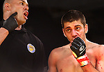A trainer points to opponent's corner that he could not fight another round because Jake Morris had broken his jawbone.