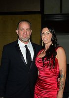 Nov. 12, 2012; Pomona, CA, USA: NHRA funny car driver Alexis DeJoria (right) with fiancé Jesse James at the NHRA awards banquet in Hollywood. Mandatory Credit: Mark J. Rebilas-