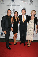MIAMI, FL - NOVEMBER 10:  Helio Castroneves, Adriana Henao, Gil De Ferran, Guest attend Destination Fashion 2012 To Benefit The Buoniconti Fund To Cure Paralysis, the fundraising arm of The Miami Project to Cure Paralysis, on November 10, 2012 in Miami, Florida.  © MPI10/MediaPunch Inc