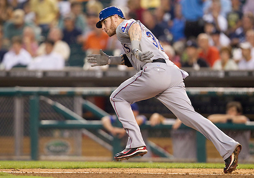 August 02, 2011:  Texas Rangers center fielder Josh Hamilton (#32)runs to first base during MLB game action between the Texas Rangers and the Detroit Tigers at Comerica Park in Detroit, Michigan.  The Tigers defeated the Rangers 6-5.