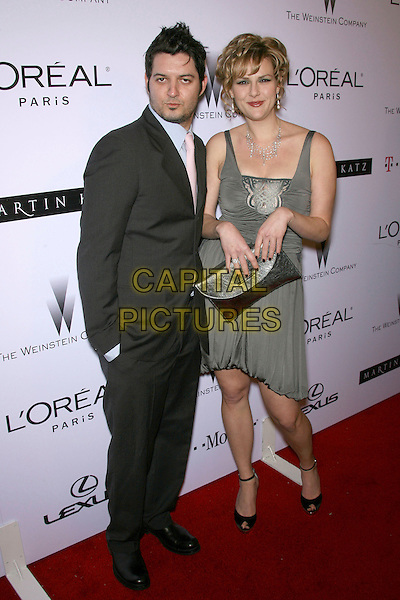 SARA RUE & GUEST.The Weinstein Company's 2007 Golden Globes After Party held at Trader Vic's at the Beverly Hilton Hotel, Beverly Hills, California , USA..January 15th, 2007.full length grey silver dress metallic clutch bag gray purse necklace black jacket.CAP/ADM/ZL.©Zach Lipp/AdMedia/Capital Pictures