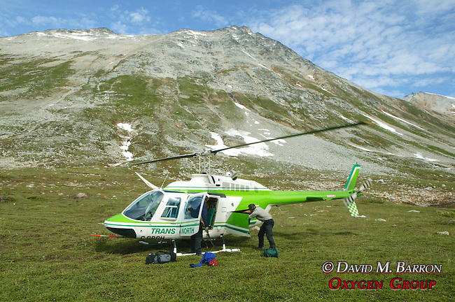 Unpacking Helicopter After Landing In Valley