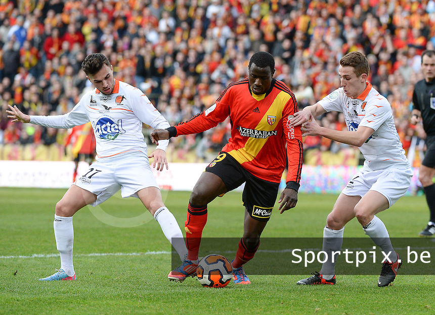 20140201 - LENS , FRANCE : RC Lens's Adamo Coulibaly (m) pictured surrounded by Laval's Kevin Perrot (r) and Martin Mimoun (l)  during the soccer match between Racing Club de LENS and Stade Lavallois , on the twenty second matchday in the French Ligue 2 at the Stade Bollaert Delelis stadium , Lens . Saturday 1st February 2014. PHOTO DAVID CATRY