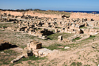Sabratha, Libya, North Africa - Roman ruins, reconstructed 1920s.  Byzantine wall, built 6th. century to defend against Berber attack.  Residential area in foreground.