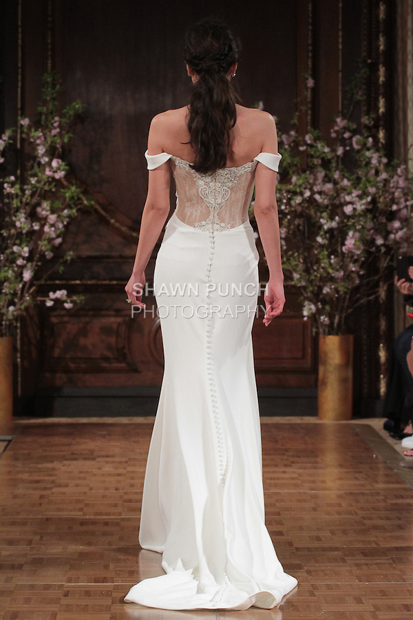 "Model walks runway in a ""Montana"" bridal gown from the Isabelle Armstrong Spring Collection 2017, at Lotte New York Palace Hotel, during New York Bridal Fashion Week Spring Summer 2017 on April 16, 2017."
