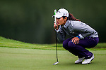 Xiyu Lin of China lines up a putt during the Hyundai China Ladies Open 2014 on December 12 2014 at Mission Hills Shenzhen, in Shenzhen, China. Photo by Li Man Yuen / Power Sport Images