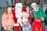 Baby Juste Beleviciute gets a hug from Santa on Saturday in Tralee in conjunction with CH Chemist with Juste were Custe and Astra Beleviciute Caherciveen and Santa Helper Mike Lynch (Elf).