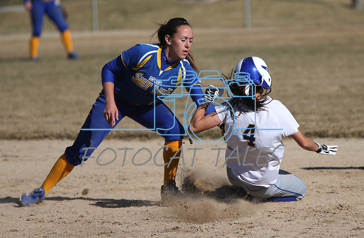 Salt Lake's Maddy Woodard tags out Western Nevada Wildcat Madison Gonzales during a college softball game on Friday, Feb. 15, 2013, in Carson City, Nev. SLCC took game one 4-2..Photo by Cathleen Allison
