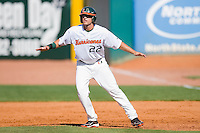 Chris Pelaez #22 of the Miami Hurricanes takes his lead off of first base against the Florida State Seminoles at the 2010 ACC Baseball Tournament at NewBridge Bank Park May 26, 2010, in Greensboro, North Carolina.  The Hurricanes defeated the Seminoles 9-3.  Photo by Brian Westerholt / Four Seam Images