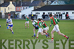 St Mary's John Golden pulls away from the challenges of St Michaels/Foilmore's  Brian Galvin and D.J. Moran.