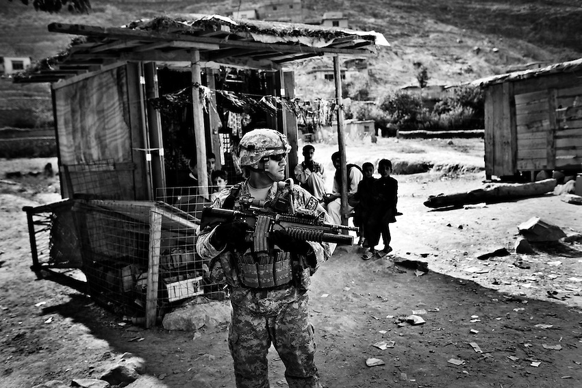 After meeting with local elders, members of 2nd Platoon, Dagger Company, 2-12th Infantry patrol in the village of Sundray in the Pesh Valley, Kunar Province, Afghanistan, Saturday, Sept 26, 2009.