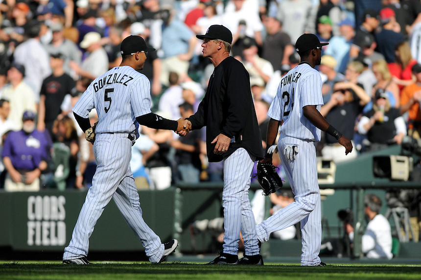 09 April 2010: Colorado Rockies manager Jim Tracy congratulates outfielders Carlos Gonzalez (5) and Dexter Fowler during a Major League Baseball game between the Colorado Rockies and the San Diego Padres at Coors Field in Denver,  Colorado. The Rockies beat the Padres 7-0 in the Coors Field home opener.  *****For Editorial Use Only*****