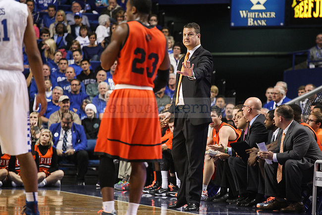 Pikeville head coach Kelly Wells gives instructions to his team during the first half of exhibition game between Kentucky and Pikeville at Rupp Arena on Sunday, November 2, 2014 in Lexington, Ky. Photo by Adam Pennavaria | Staff