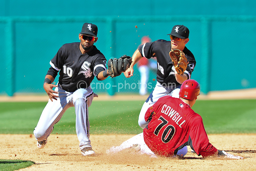 Mar 7, 2011; Tucson, AZ, USA; Chicago White Sox shortstop Alexei Ramirez (10) and second baseman Brent Lillibridge (18) both attempt to field the ball during a stolen base attempt by Arizona Diamondbacks outfielder Collin Cowgill in the 5th inning of a charity exhibition game at the Kino Sports Complex.