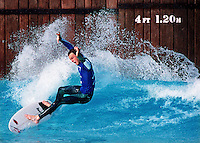 Professional surfer Shane Beschen expressively reacts as he attempts to keep his balance while riding a wave in Disney's Typhoon Lagoon wave pool during the Surf Expo Surf Challenge II in Orlando, Florida.