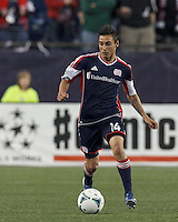 New England Revolution midfielder Diego Fagundez (14) brings the ball forward. In a Major League Soccer (MLS) match, the New England Revolution (blue) tied New York Red Bulls (white), 1-1, at Gillette Stadium on May 11, 2013.