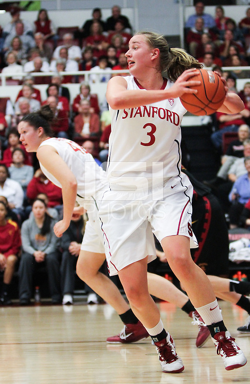 STANFORD, CA - January 22, 2011:  Mikaela Ruef takes down a defensive rebound and looks up court during Stanford's 95-51 victory over USC at Stanford, California on January 22, 2011.